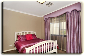 Curtains by Rian's Windpw Treatments